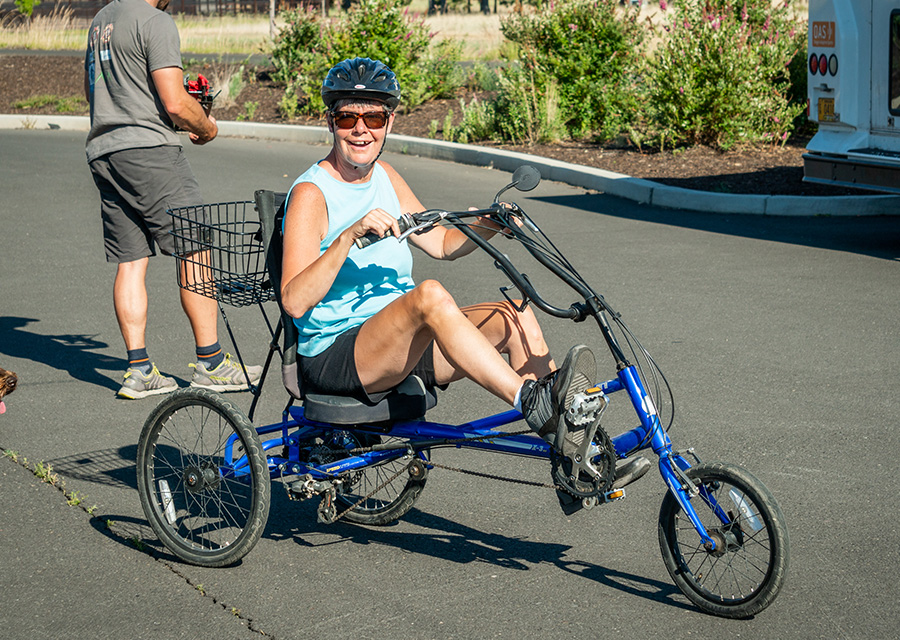 adult with a disability on a recumbent cycle