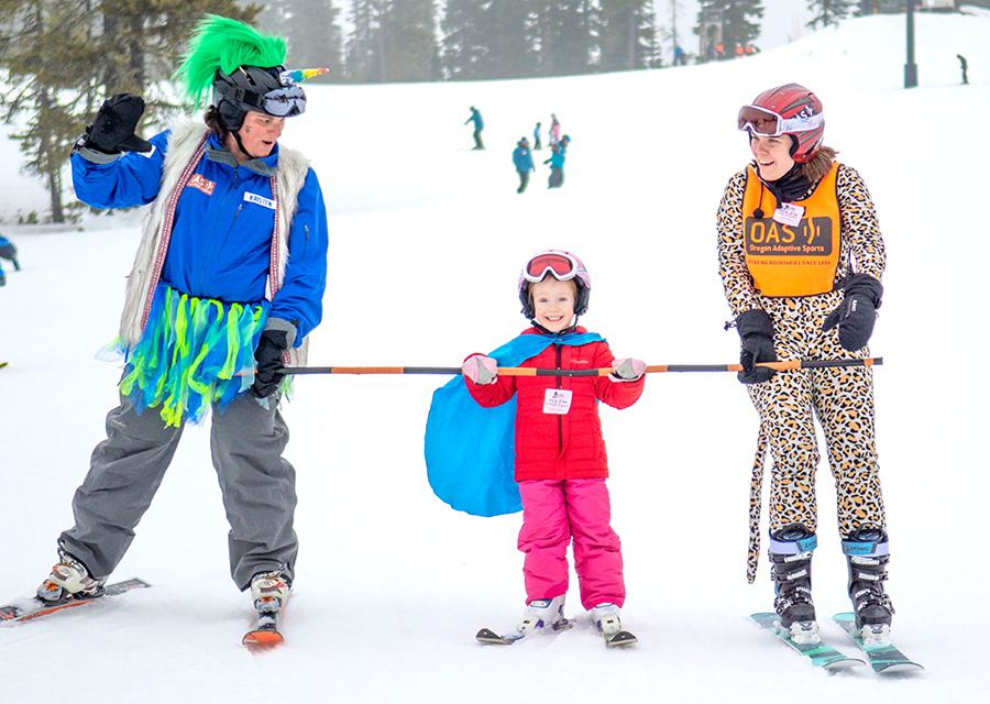 youth skier using bamboo pole wearing a costume