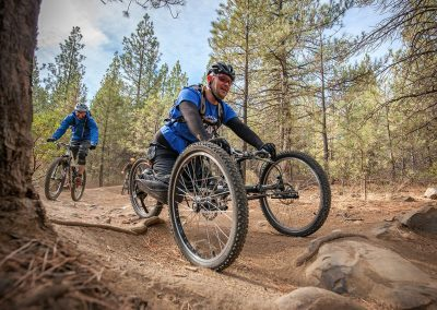 athlete on hand cycle on central oregon single track