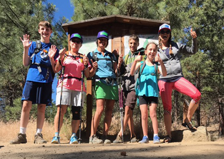 group of kids at a hiking trailhead