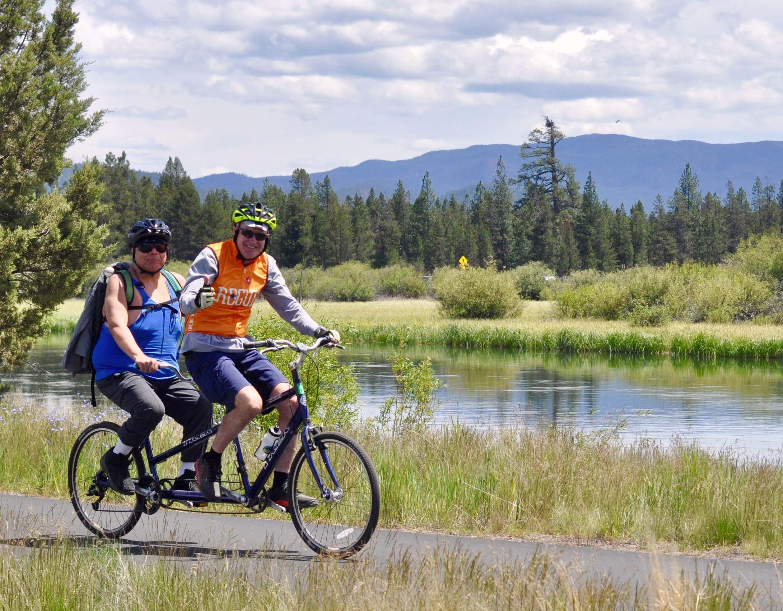 Volunteer and participant on tandem cycle