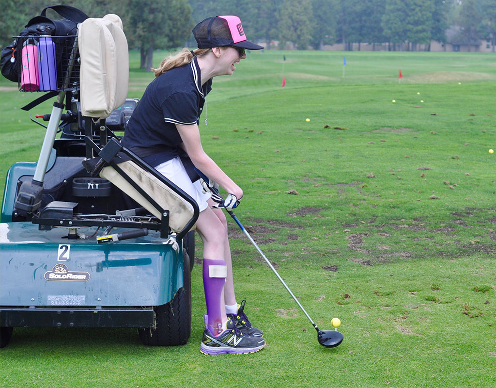 adaptive athlete golfing using adaptive cart at awbrey glen golf course
