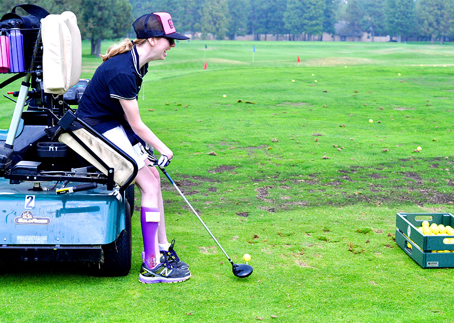golfer using an adaptive golf cart
