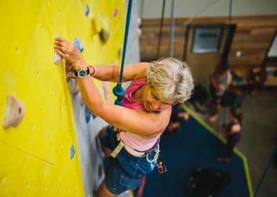 adaptive athlete climbing at bend rock gym