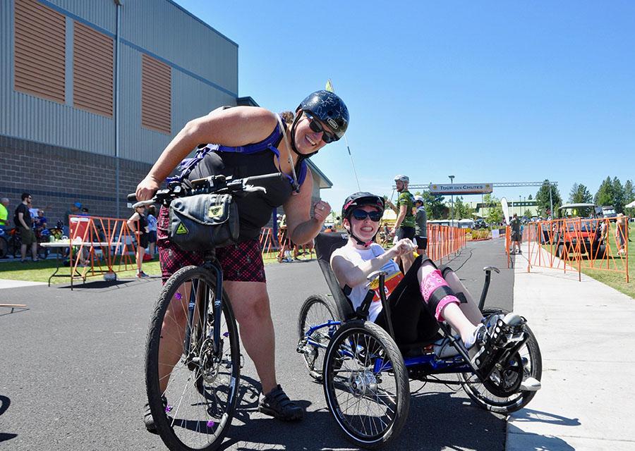 cyclist on recumbent bike with volunteer