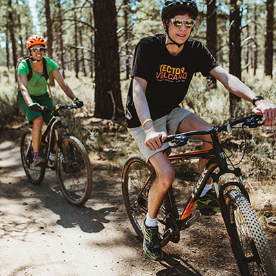 two mountain bikers riding on trails