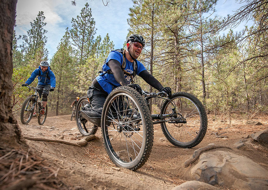 rider with a disability on a forward facing off road handcycle