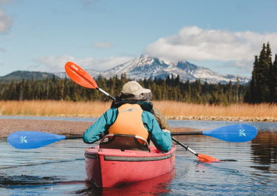 paddlers with mountains in background