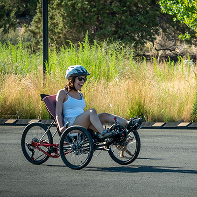woman on recumbent trike riding outdoors