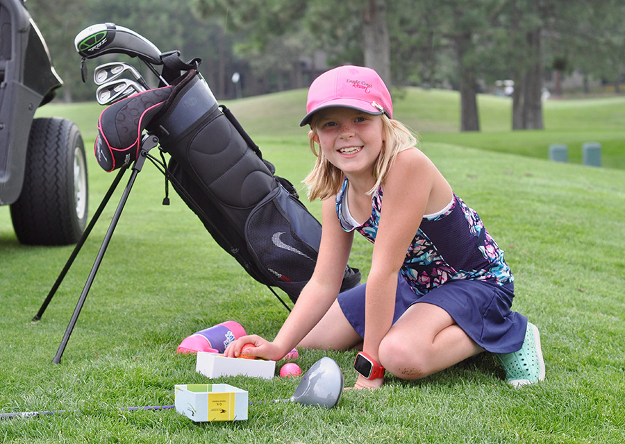 young golfer with bag of golf clubs