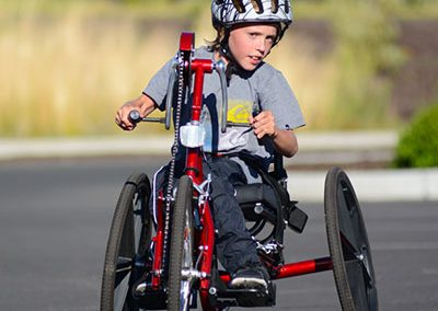 youth on hand cycle