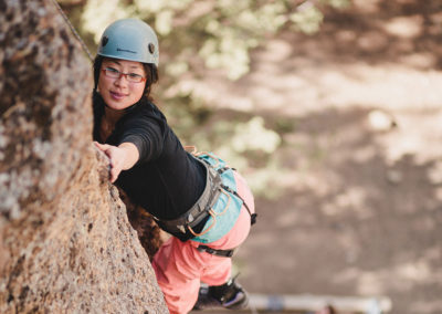 adaptive climber making move on climb at smith rock state park