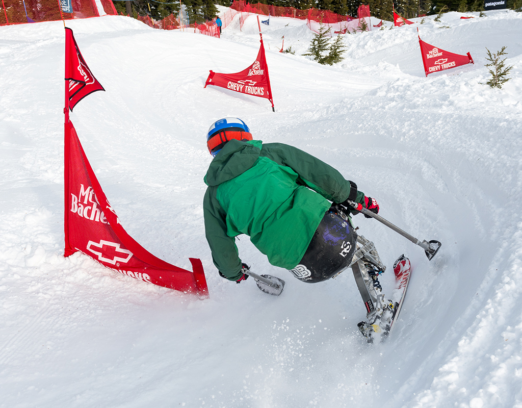 athlete sit skier ravi drugan skiing through the banked slalom course of the dirksen derby