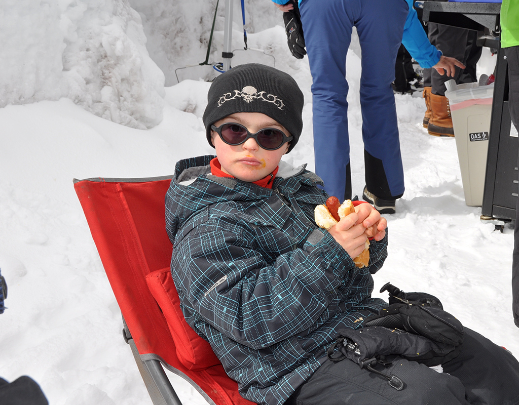 kiddo looking very serious about his hot dog at year end bbq