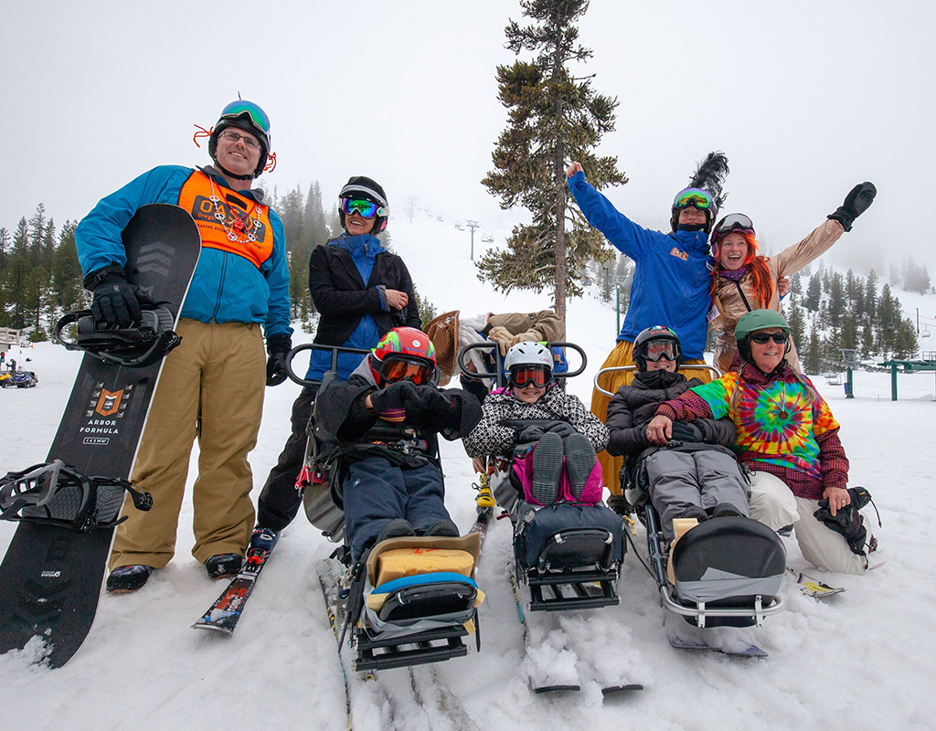 group of kiddos in sit skis in costume on junior racers day