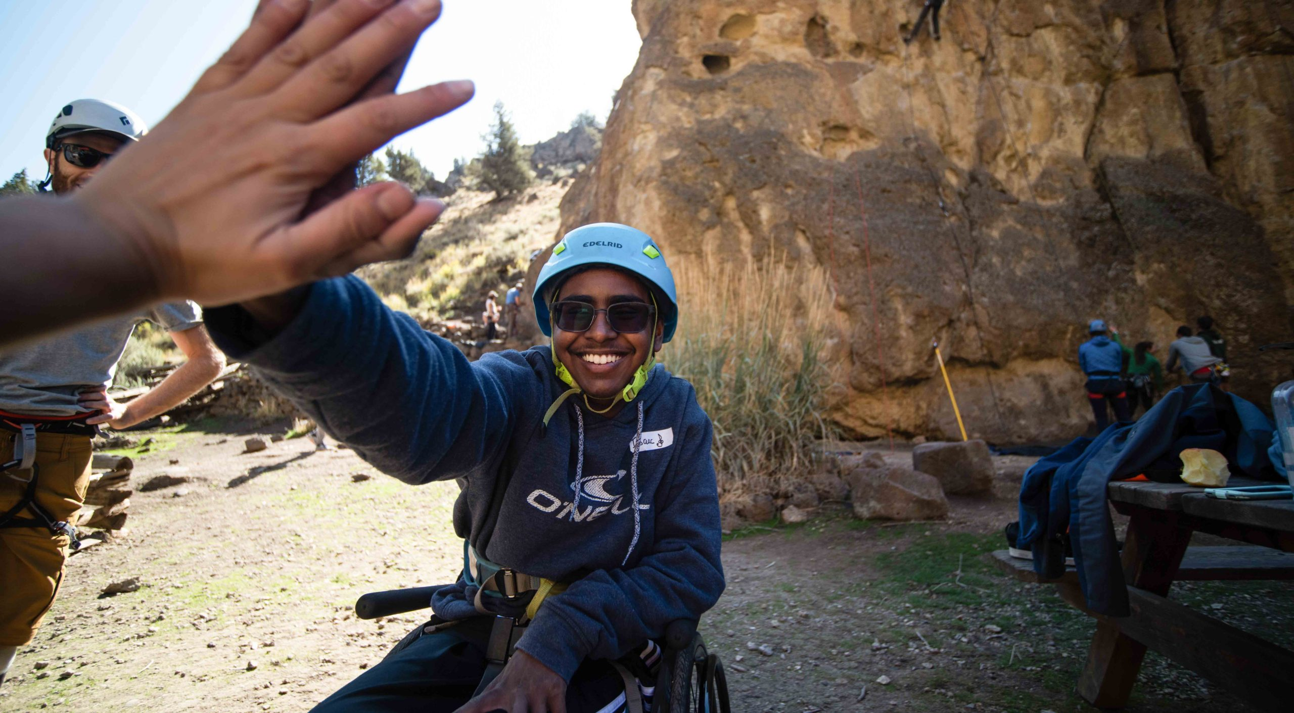 person in a wheelchair high fiving the photographer at Smith Rock