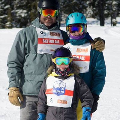 photo of michael and his two daughters on the mountain