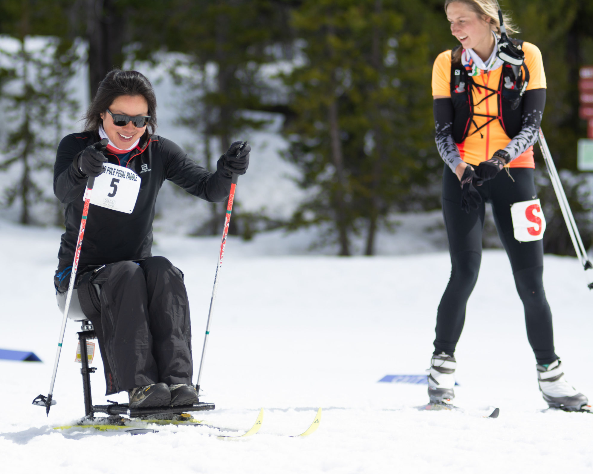 oas athlete anna pushing uphill in nordic sit ski at ppp