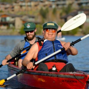 athlete darwin and VI guide paddling down river in PPP