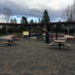 playground and picnic tables with flat paved ground