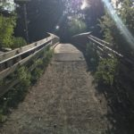 bumpy rutted packed gravel to bridge transition at columbia park