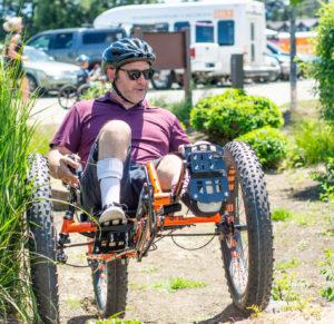 athlete on recumbent foot powered fat bike