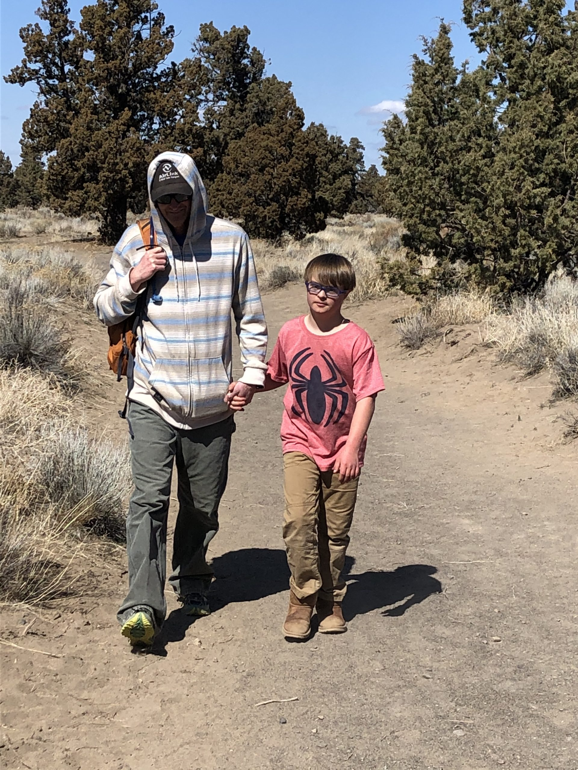leahs son miles and husband andrew on a walk