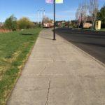 paved concrete sidewalk of old mill loop