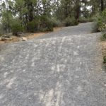 steep gravel slope on canal trail