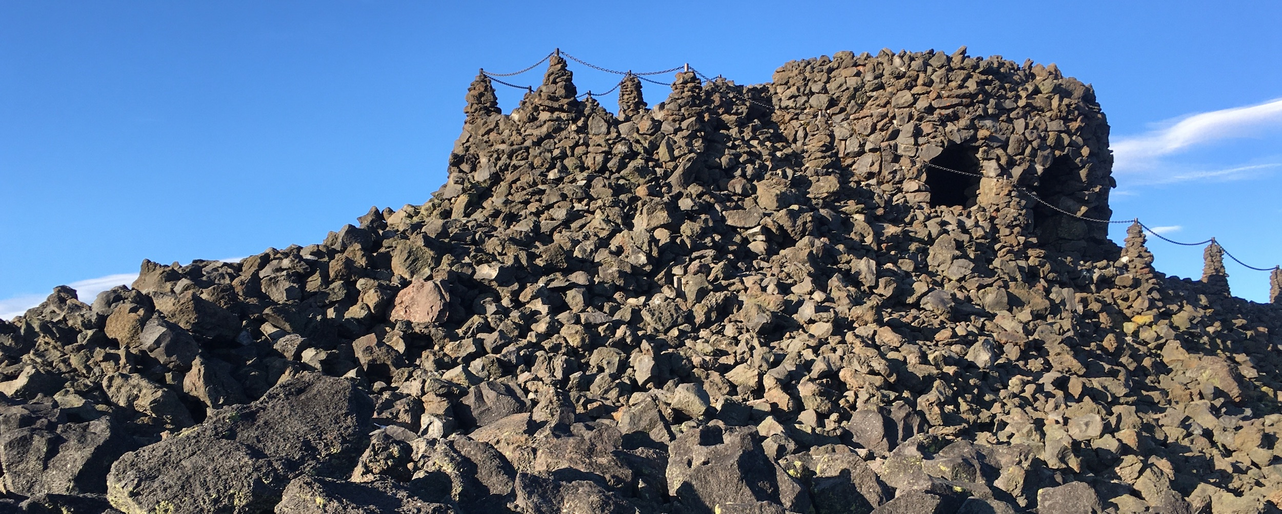 lava rock pile / hill with observatory built into rock at top