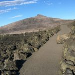 dee wright observatory paved path with rock in trail