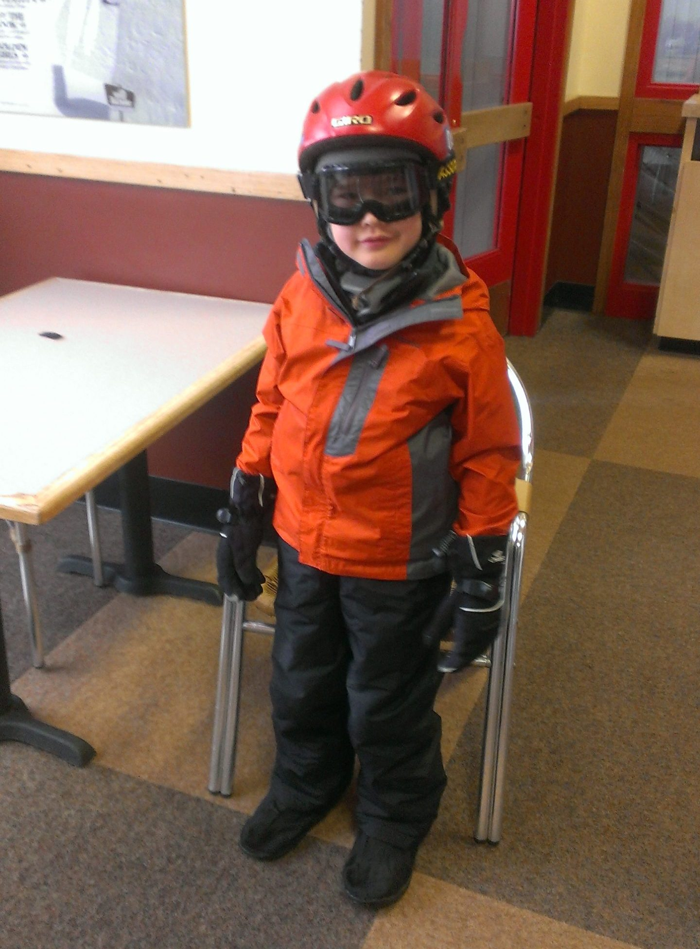 young Ken in ski clothes, helmet, goggles