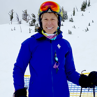 kathy farrell wearing ski helmet and goggles, snowy background