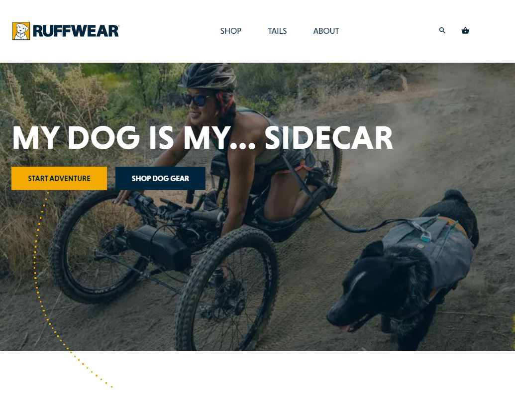 Ruffwear website showing a hand-cyclist and their dog