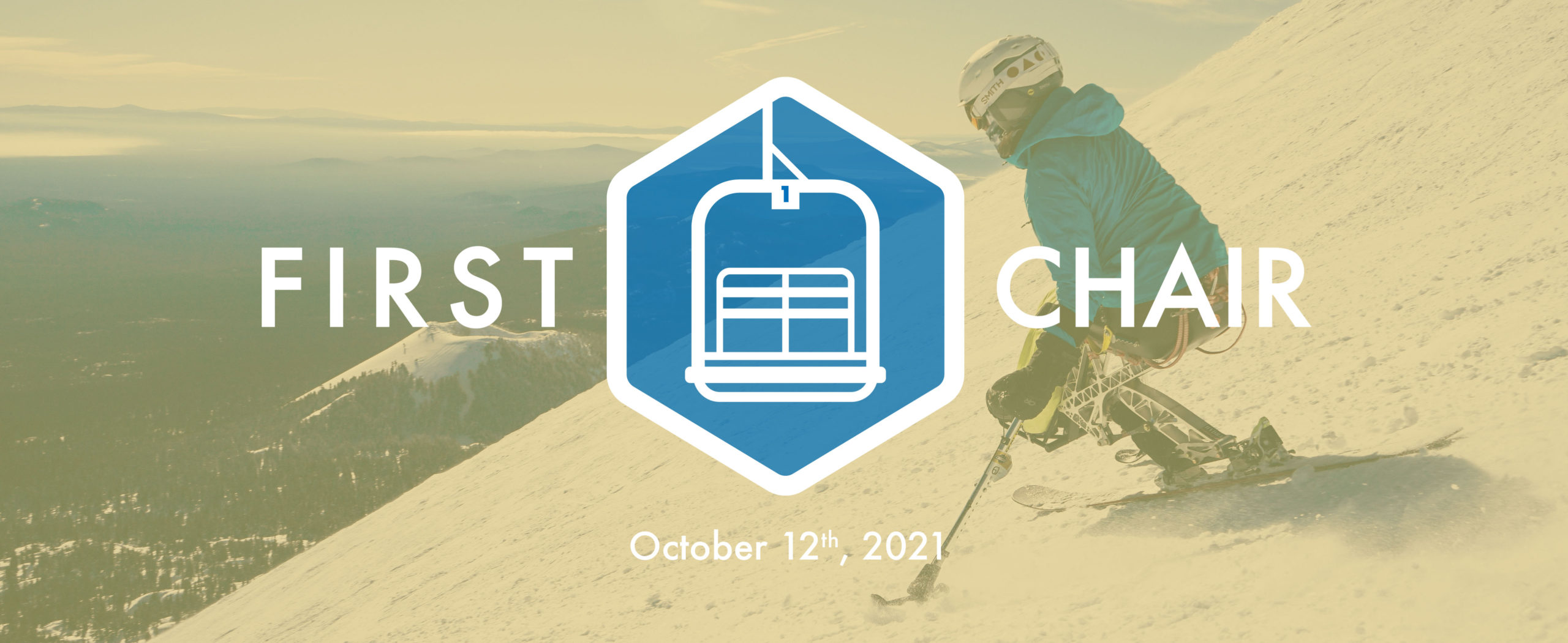 first chair logo with a sit skier in the background